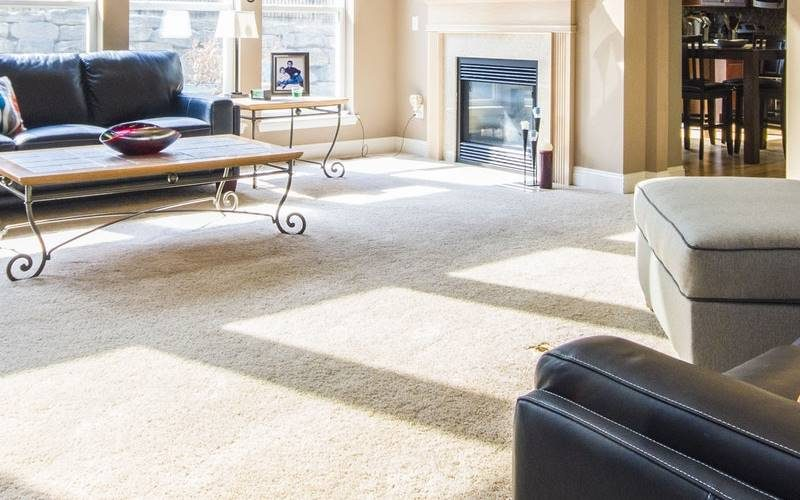 Tan colored floor with carpet