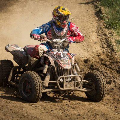 Four wheeler racing in mud