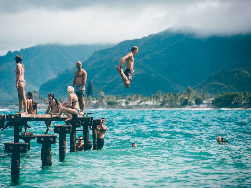 Jumping in lake from dock
