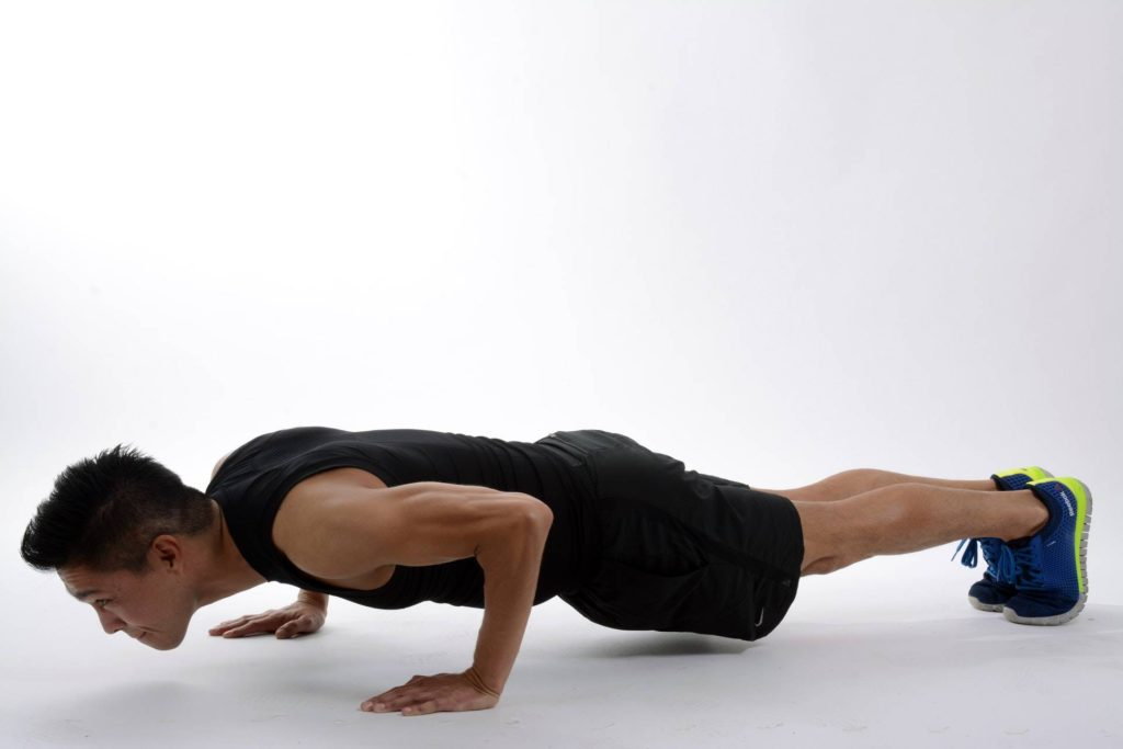 Man doing a pushup without equipment