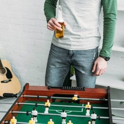 Man after setting up foosball table