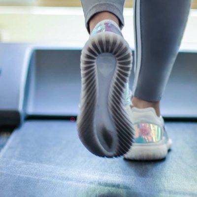 Feet walking on a treadmill