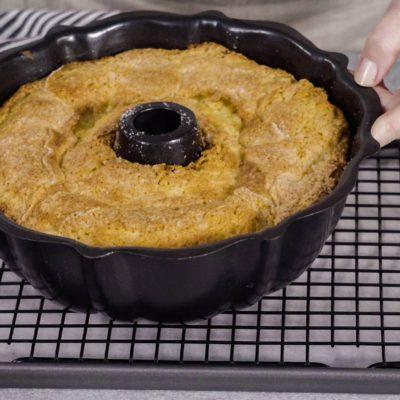 Cooling freshly baked a lemon pound cake on a cooling kitchen rack.